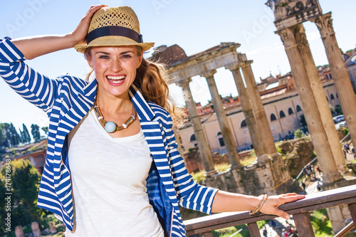 Foto op Aluminium Rome cheerful elegant woman in front of Roman Forum in Rome, Italy