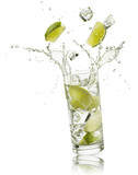 glass full of water with lime slices and ice cubes falling and splashing water, on white background