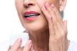 Quadro senior woman applying face cream