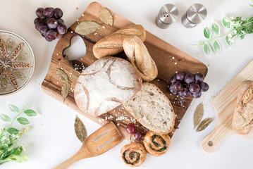 Sliced bread on the wooden cutting board. Breakfast