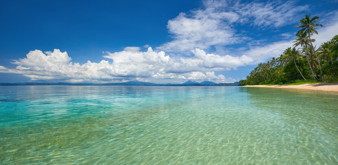 Panoramic view of tropical beach on background the islands