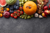 Autumn harvest concept. Seasonal fruits and vegetables on a stone tabletop, top view - 174259693