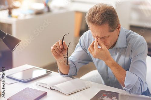 Sick mature man feeling a headache