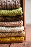 Pile of warm hand knit winter clothes - 174262463