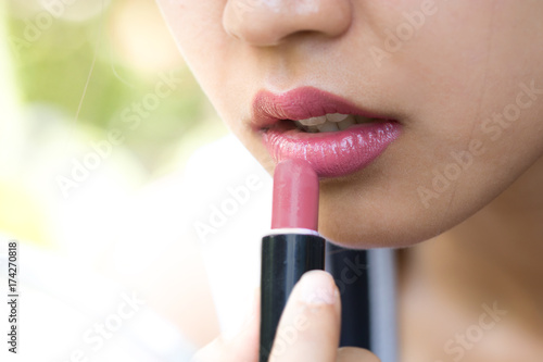 Woman is wearing a pink lipstick. Poster