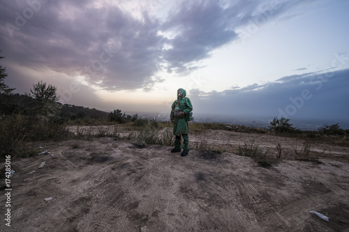 man in a gas mask in a polluted city,stalker