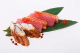 Sashimi set on bamboo leaf isolated at white