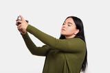 woman in a khaki blouse - 174294436
