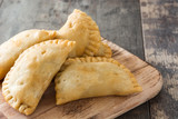 Typical Spanish empanadas on wooden table - 174304231