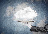 Hand of waitress presenting cloud on tray. - 174312474