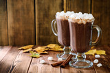 Hot chocolate with marshmallow in glass cups on wooden background - 174312608