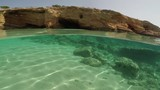 The bottom of an exotic beach on half underwater view in Koufonissi island, Greece - 174315887