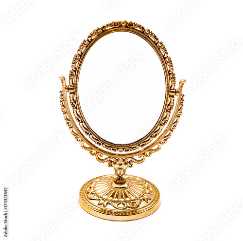 Old golden mirror with copy space isolated on white background.