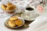 Madeleine, served with coffee. Traditional French pastries. Romantic breakfast. Style ryustik, selective focus. - 174322284