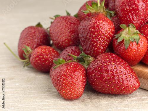 Beautiful ripe strawberry on a fabric background