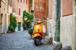 Quadro Old fashioned motorbike on a street of Trastevere, Rome
