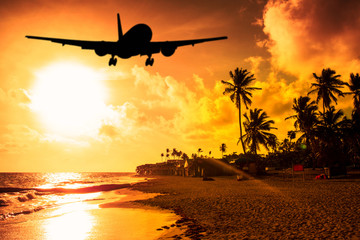 Beach Sunset and airplane lending
