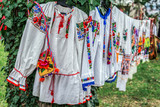 Old traditional Romanian folk costumes with embroidery - 174397021