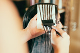 Hairdresser coloring hair in studio - 174406210