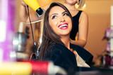 Woman getting her hair dried at the hair salon - 174406402