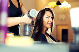 Portrait of a happy woman at the hair salon - 174406438