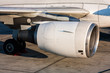 Close-up of engine and main landing gear of passenger aircraft
