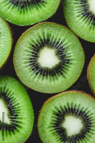 Ripe whole kiwi fruit and half kiwi fruit