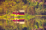 wooden cabin in forest on lake shore, Norway - 174415474