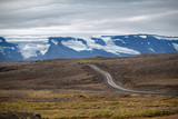 Typical Icelandic highland landscape with empty gravel road. - 174419411