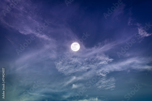 Foto op Plexiglas Aubergine Night sky with bright full moon and clouds, serenity nature background.