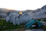 Alone tourist near his tent - 174428662