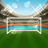 Football stadium with soccer goal net, grass and athletic track. Tribune, glitter and spotlights.