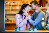Romantic couple having date in coffee shop - 174451892