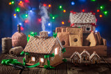 Magical Christmas gingerbread cottage in the old workshop - 174476205