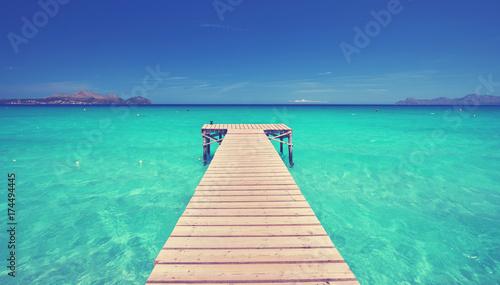 Plakat einsamer Steg am Meer