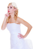 Bride in white wedding dress showing silence sign - 174512006