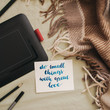 """Flat lay of artist home office in bed. Handwritten inspirational quote """"do small things with great love"""""""