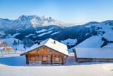 Wooden mountain chalet in the alps in winter - 174543422