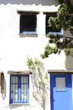 Blue shutters on white house in Portlligat, Spain. - 174555433