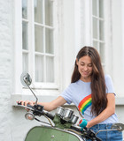 Beautiful young girl near the scooter - 174576840