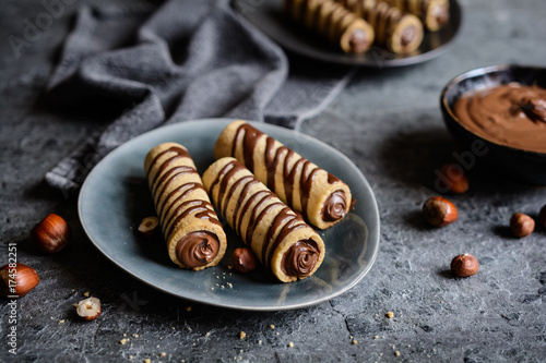 Foto op Canvas Chocolade Biscuit tubes filled with hazelnut cream and chocolate topping