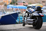 Cool motorcycle is parked on the pier of the sea terminal - 174598661