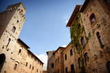 Old buildings in San Gimignano, Tuscany, Italy - 174610407