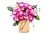 Floral pattern. Bouquet in a paper bag on white background top view copyspace - 174630499
