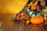 Pumpkins, gourds, and leaves in an Autumn cornucopia background - 174638894