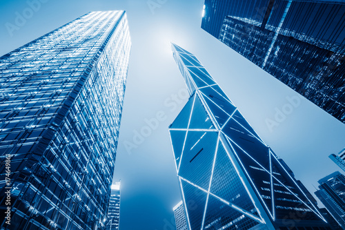 directly below of modern financial skyscrapers in central Hong Kong,blue toned,china.