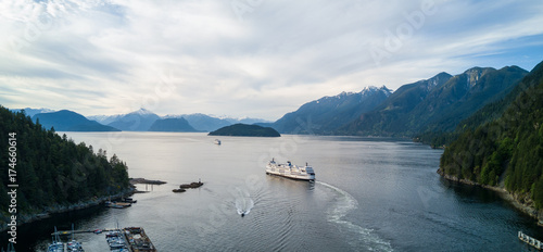 Aerial Panoramic view of Horseshoe Bay with Ferry leaving the terminal. Taken in Howe Sound, West Vancouver, British Columbia, Canada.