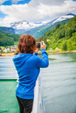 Tourist woman on liner taking photo, Norway - 174662294