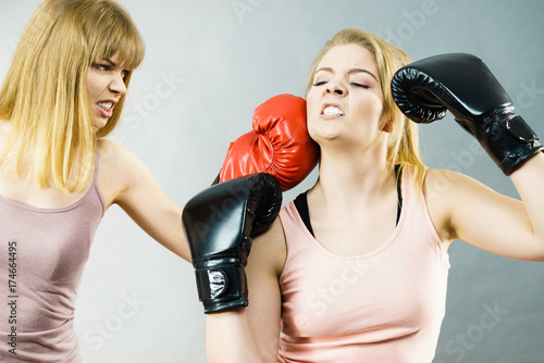 Two agressive women having boxing fight - 174664495
