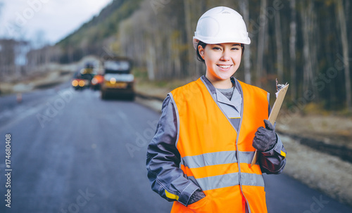 female worker road construction
